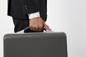 Mid section view of a businessman holding a briefcase