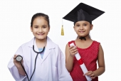 Girls imitating as a doctor and a graduate