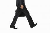 Low section view of a  businessman carrying a bag