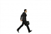 Businessman walking with a bag
