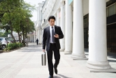 Businessman using phone while walking, Connaught Place, New Delhi, India