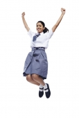 School girl jumping in the air and cheering