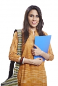Portrait of a young female journalist carrying bag and file and smiling