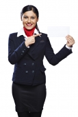 Portrait of an air hostess pointing at a card and smiling