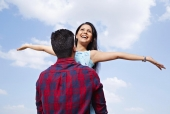 Young man lifting his girlfriend and cheering