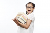 Surprised girl carrying a stack of books