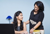 Mother helping her daughter in studies