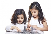 Brother and sister stacking coins