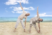 Portrait of a senior couple exercising on the beach